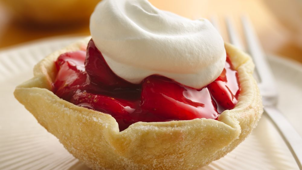 It's easier than you think:  The tart shells are made with an inverted muffin pan.  Pie crust rounds are draped over the inverted cups and baked.  Then, just fill and enjoy!