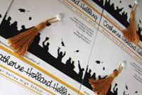 Graduation announcement styled as graduation caps by Dana Beckwith