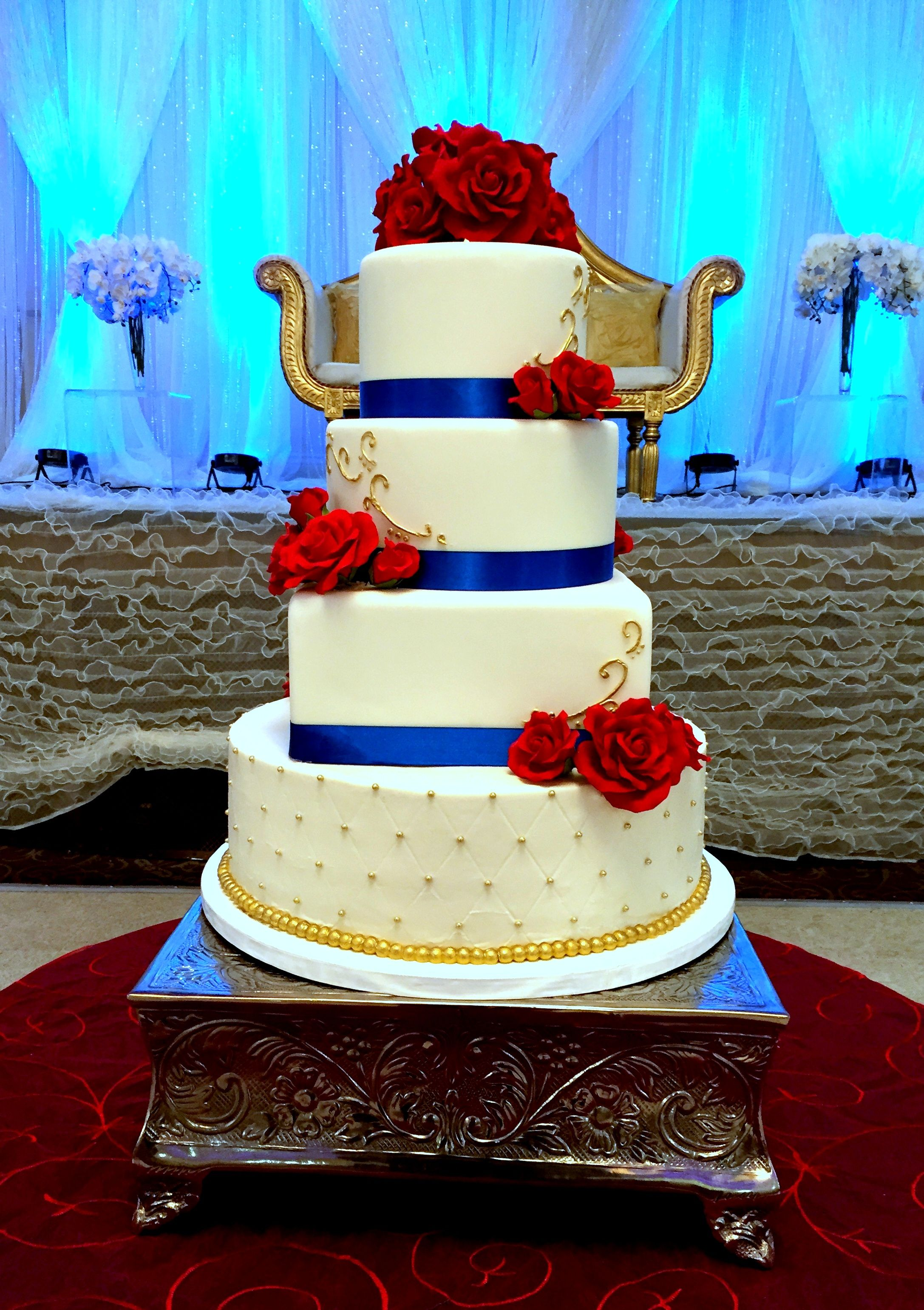 Royal Blue Red And Gold Cake Top Three Tiers Covered In