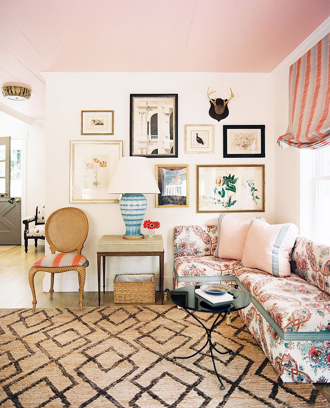 A Y Living Room With Pale Pink Ceiling Small Gallery Wall And Patterned Sofa