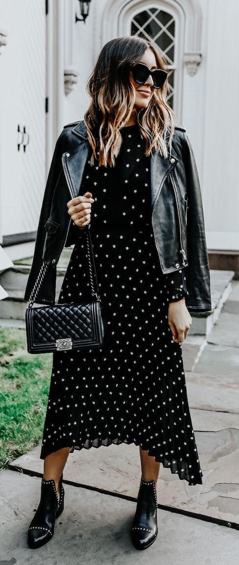 Black and white polka dot dress + leather jacket, black boots, black bag and sunglasses