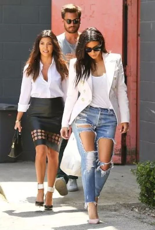 White blazer & light washed ripped jeans.