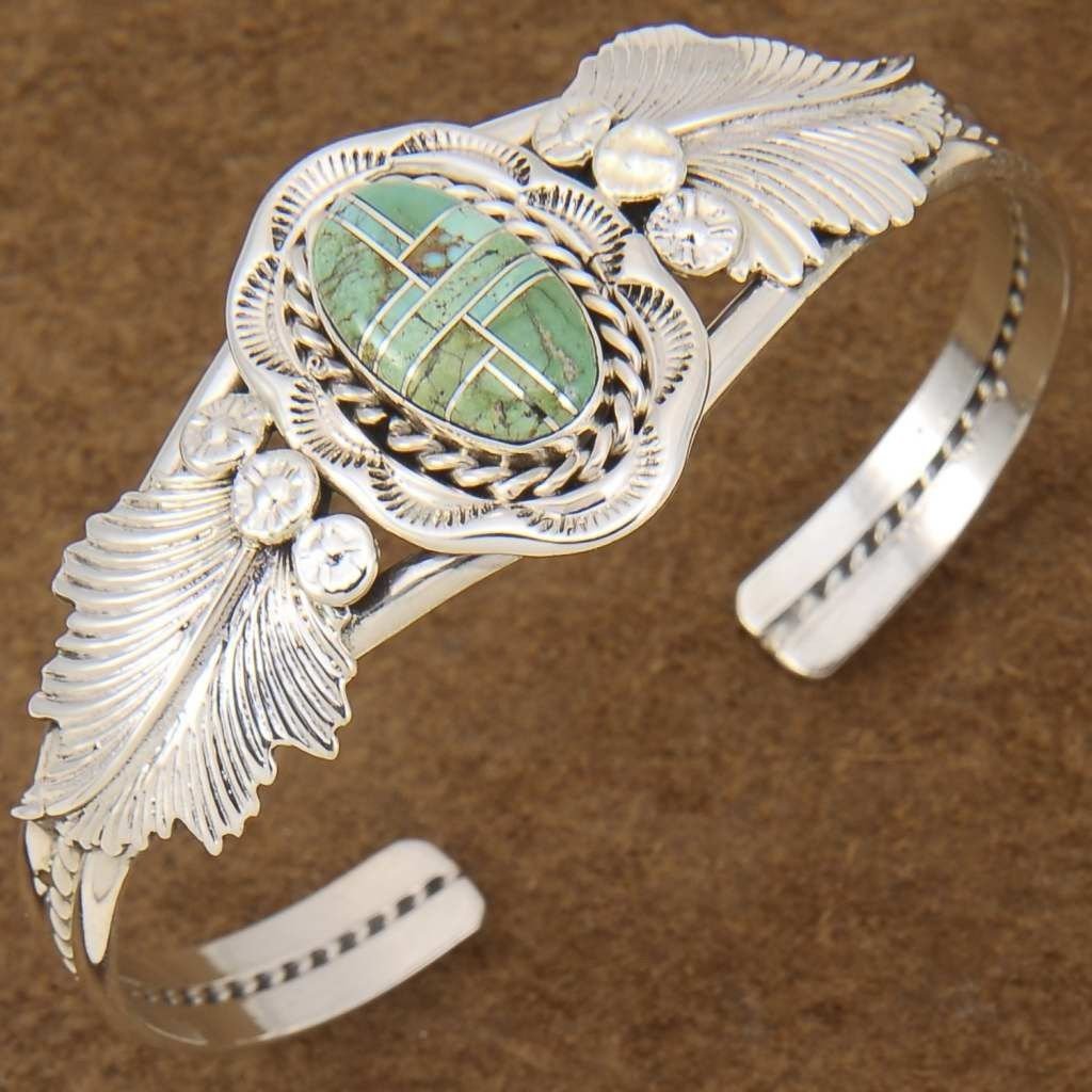 Native American Inlaid TURQUOISE STERLING SILVER CUFF BRACELET. http://www.nativeamericanstuff.net/American%20Indian%20Navajo%20Bracelets.htm