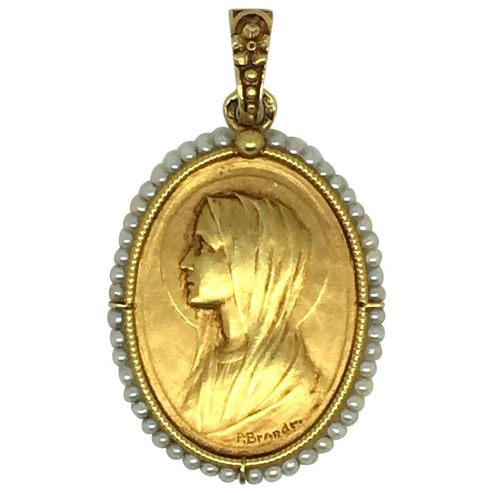 Paul emile brandt gold pendant necklace depicting mary gold