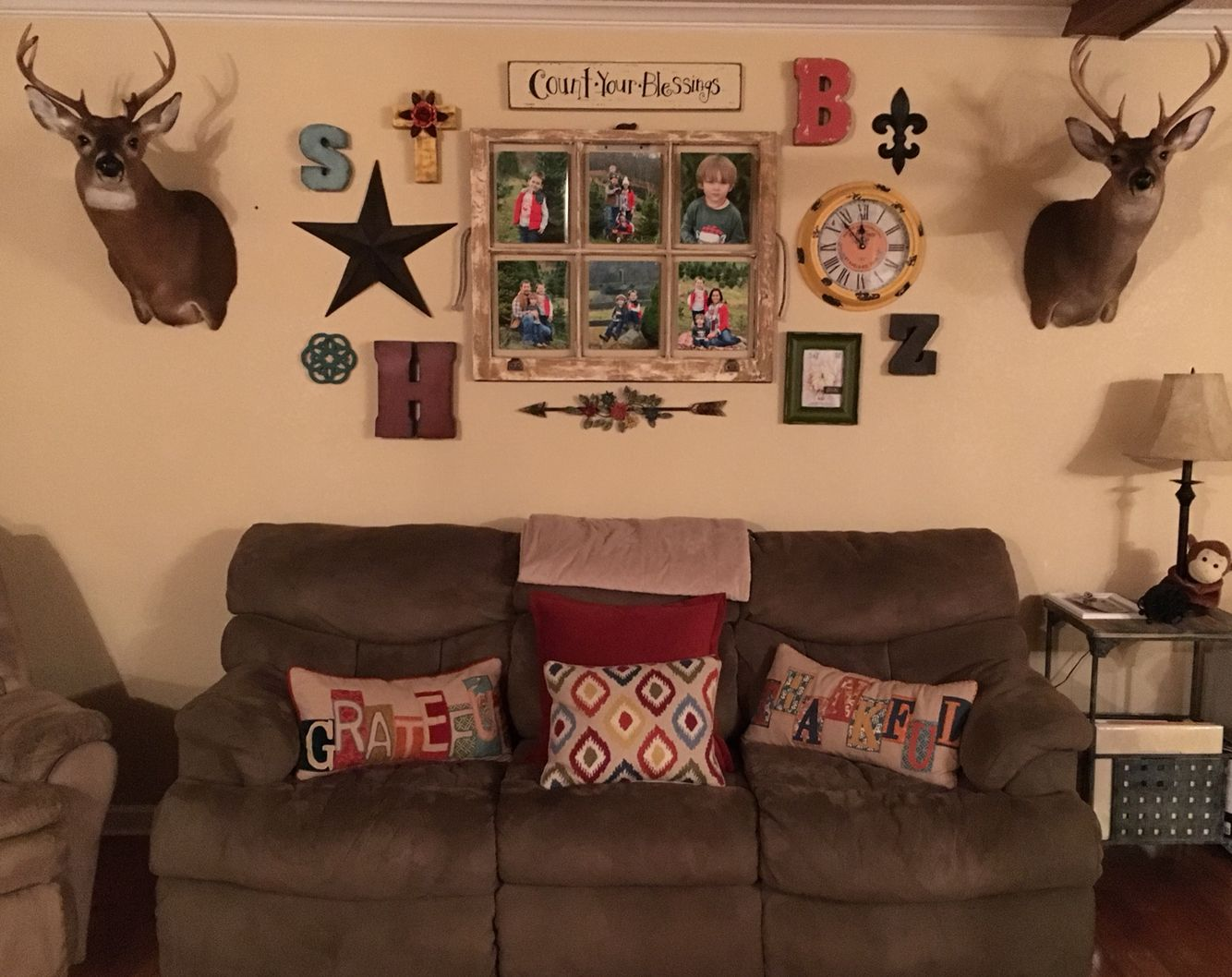 Gallery wall Old window (frame) Deer mount Living room ...