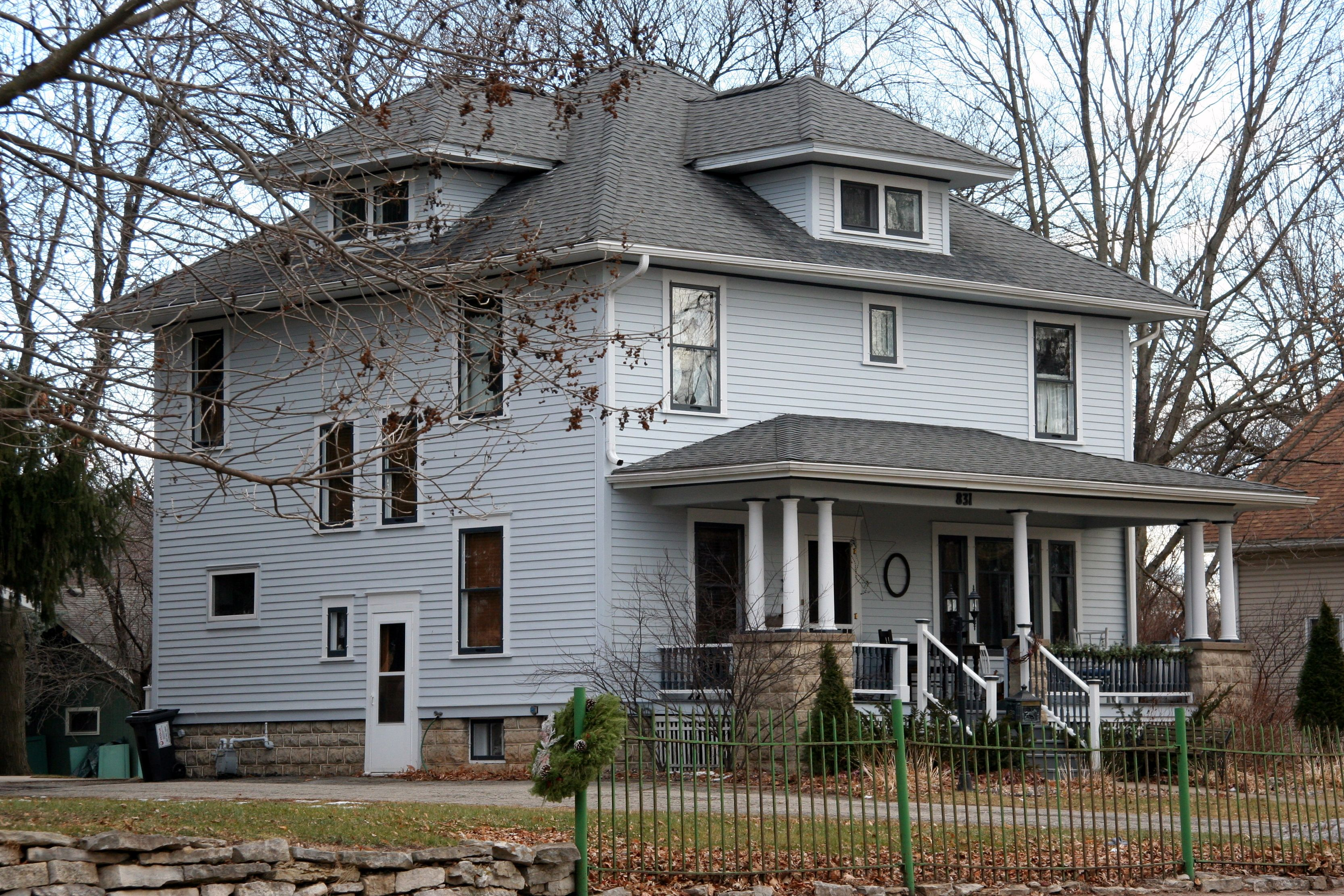 A wood frame american foursquare house in minnesota with for Architectural styles of american homes