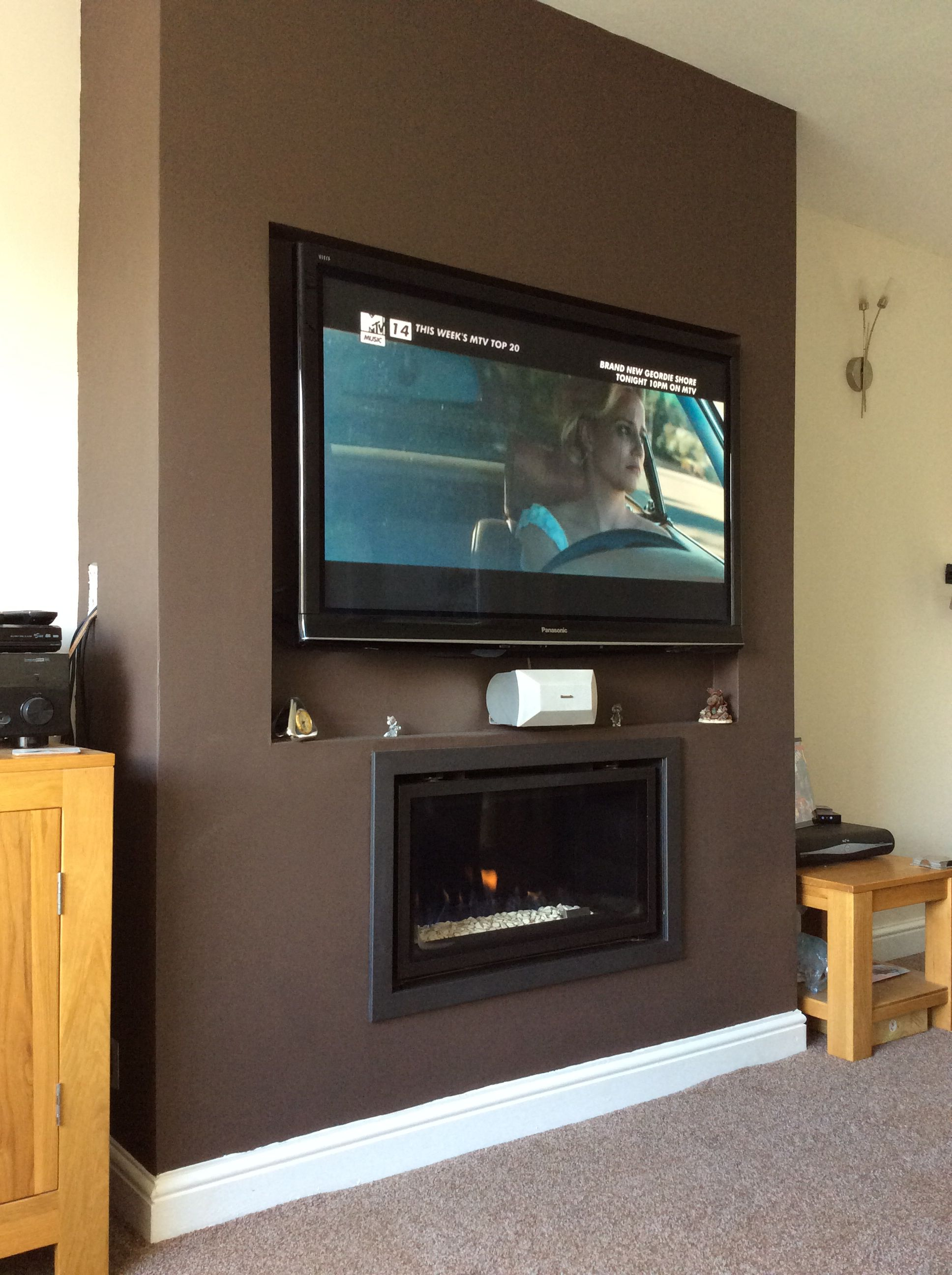 """Gasco Studio hole in the wall fire with Panasonic 50"""" TV wall mounted above"""