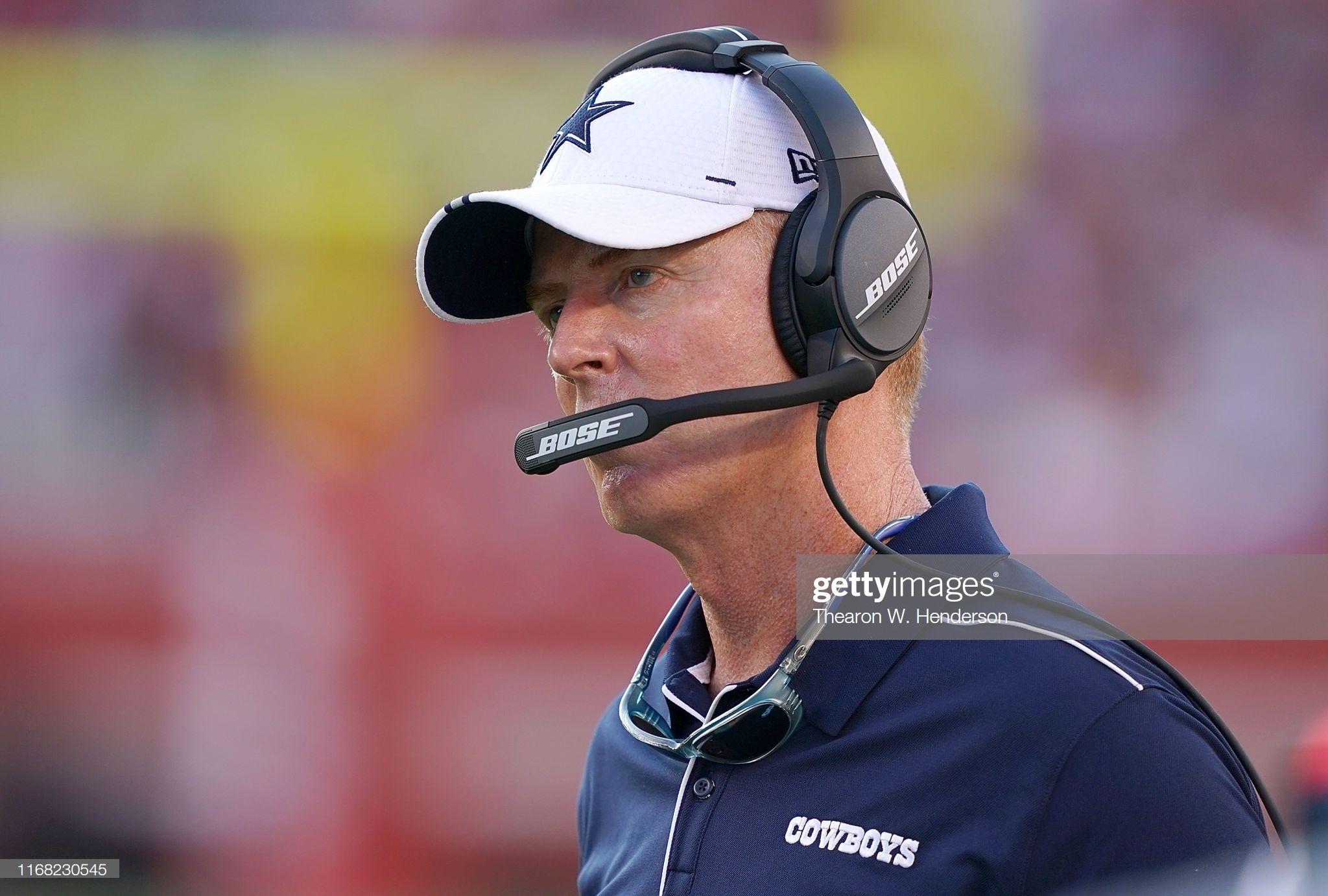 Head coach Jason Garrett of the Dallas Cowboys looks on