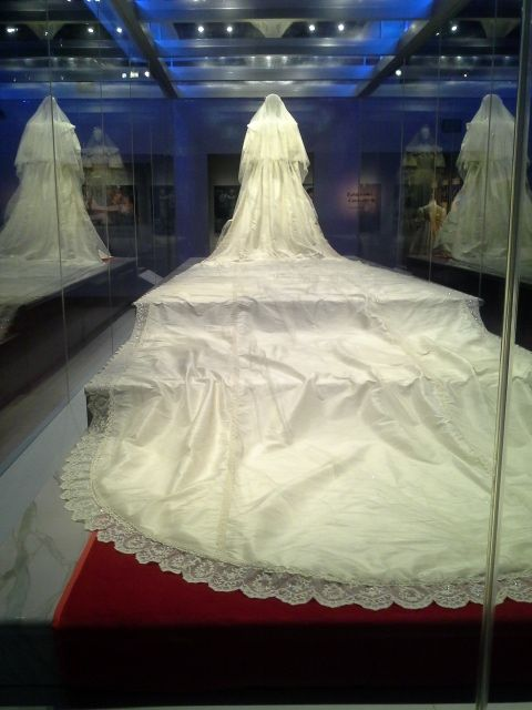 View of Princess Diana's dress from the back, including train and veil