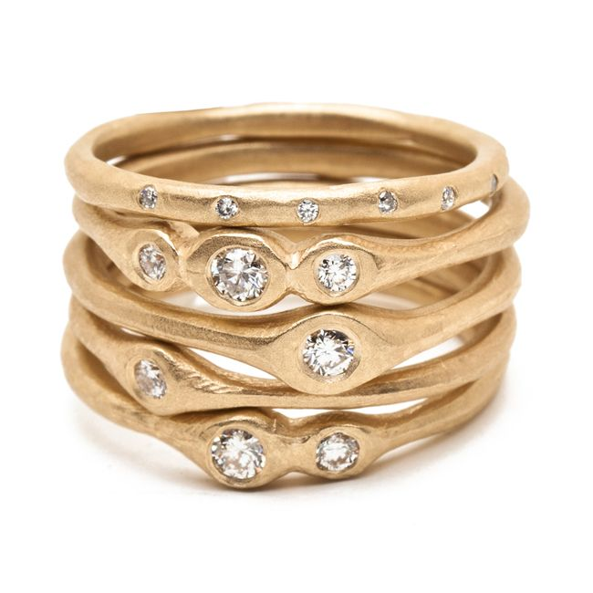 14k gold stacking ring with single medium diamond altered space