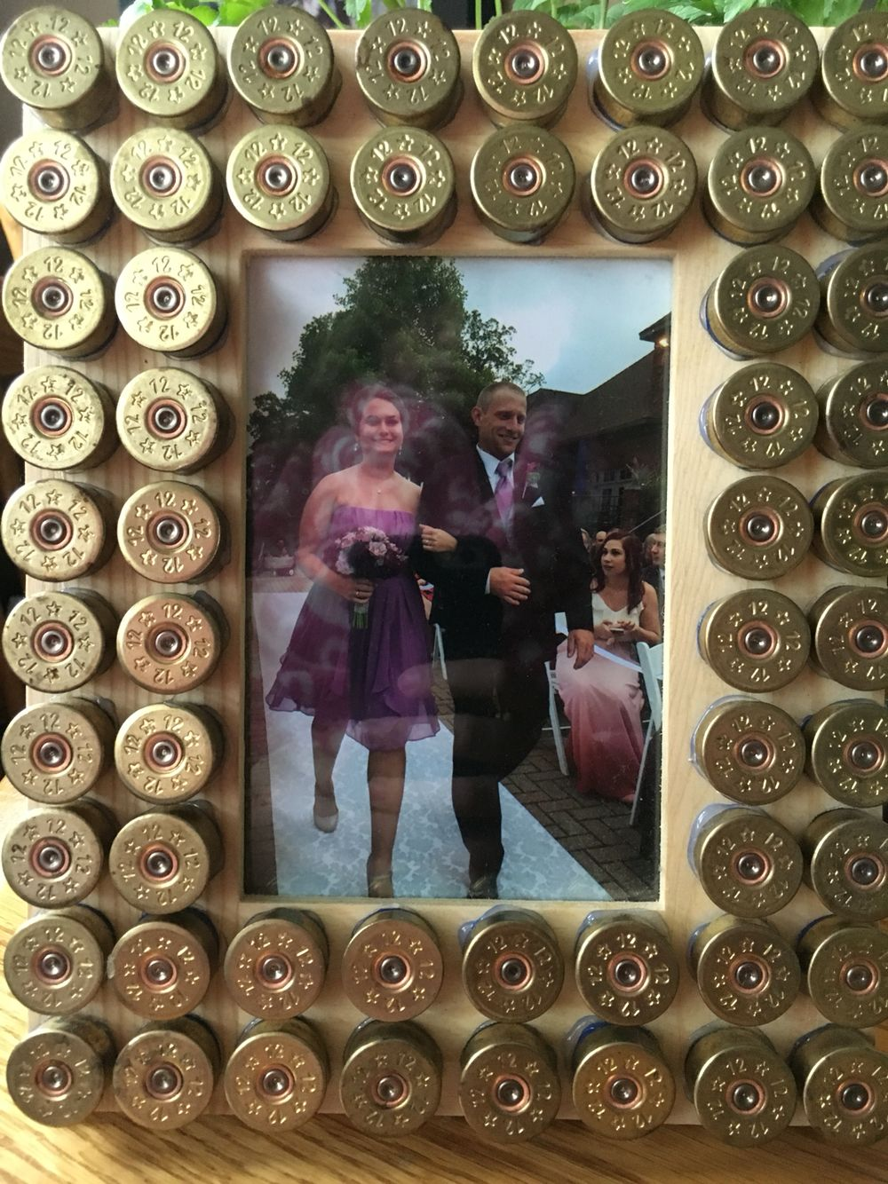 Easy DIY picture frame! Simply cut and glue the shotgun shells onto ...