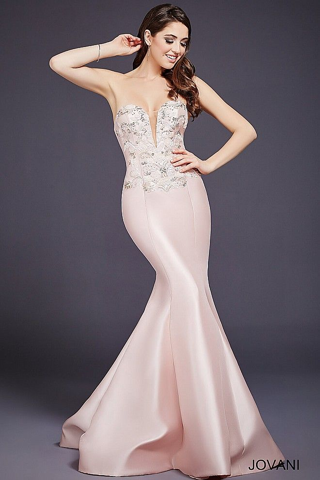 Blush strapless mermaid gown features a sheer plunging neckline ...
