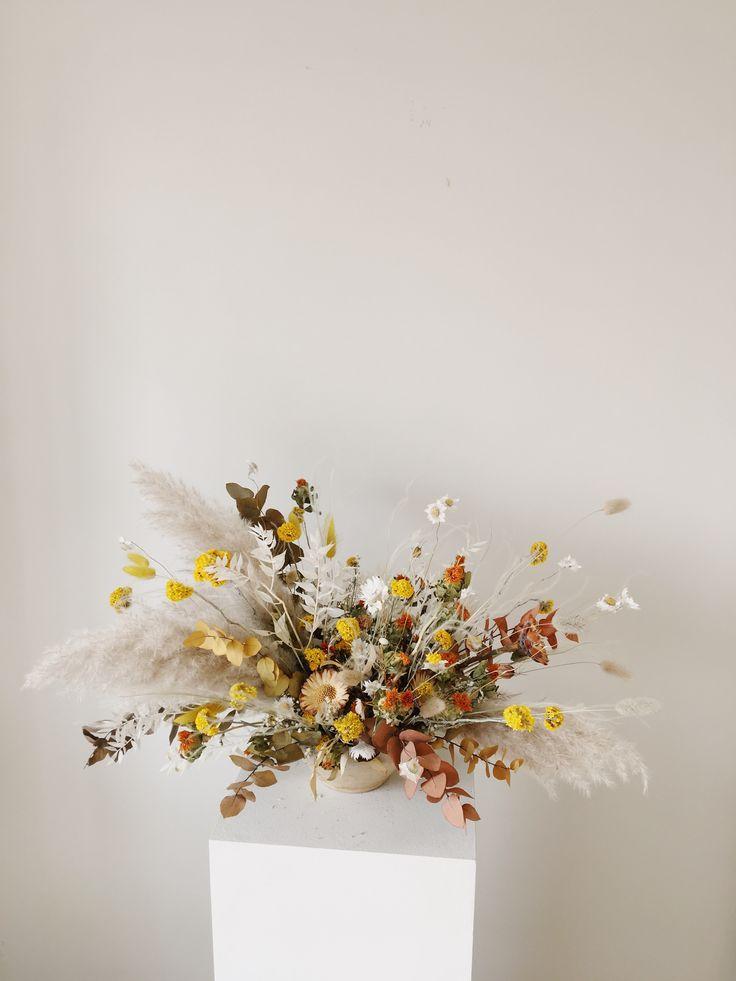 Dried flower arrangement centrepiece by flower and fern