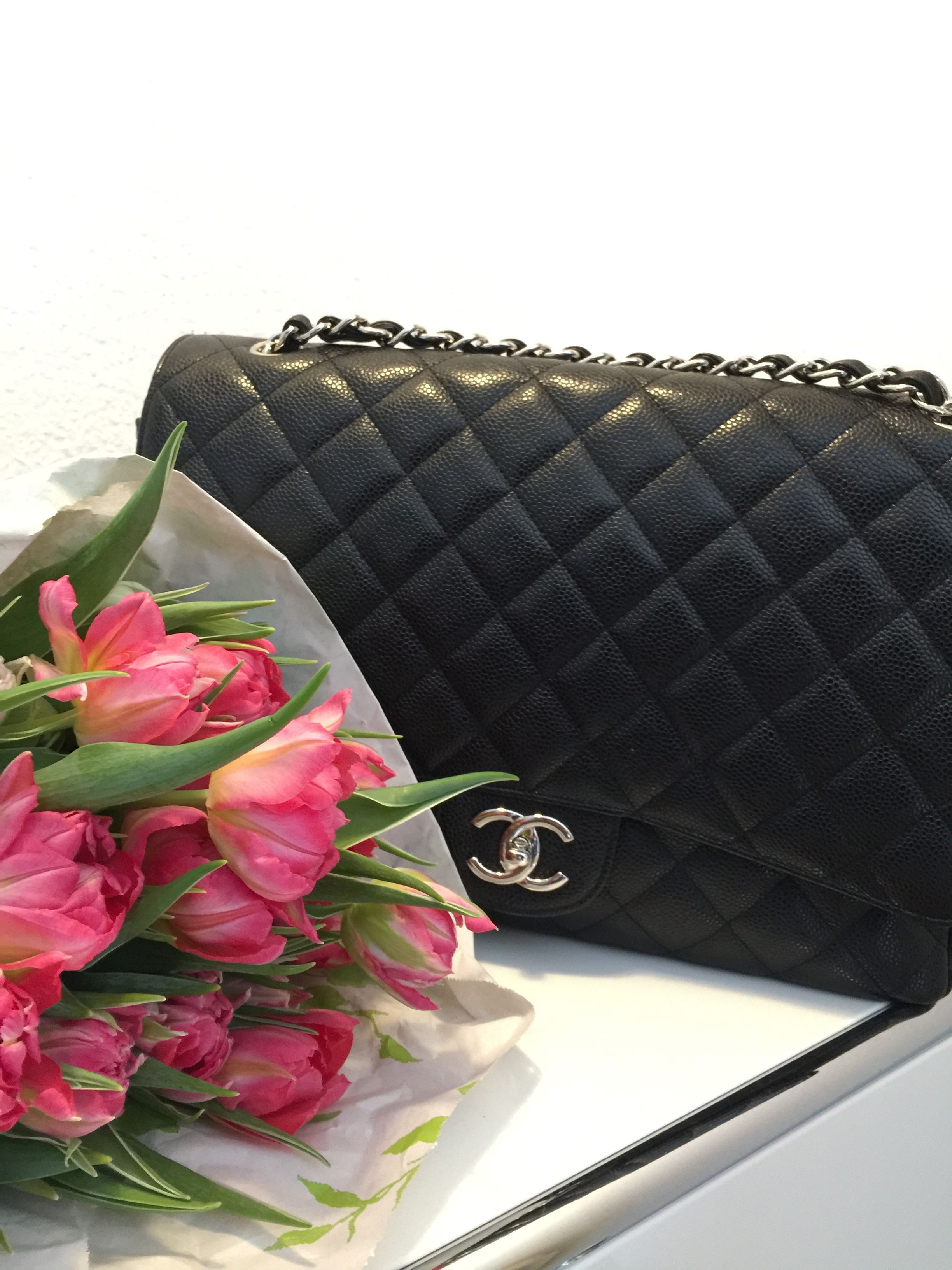 Chanel Classic Flap in black caviar leather. Maxi size for plenty of room inside.