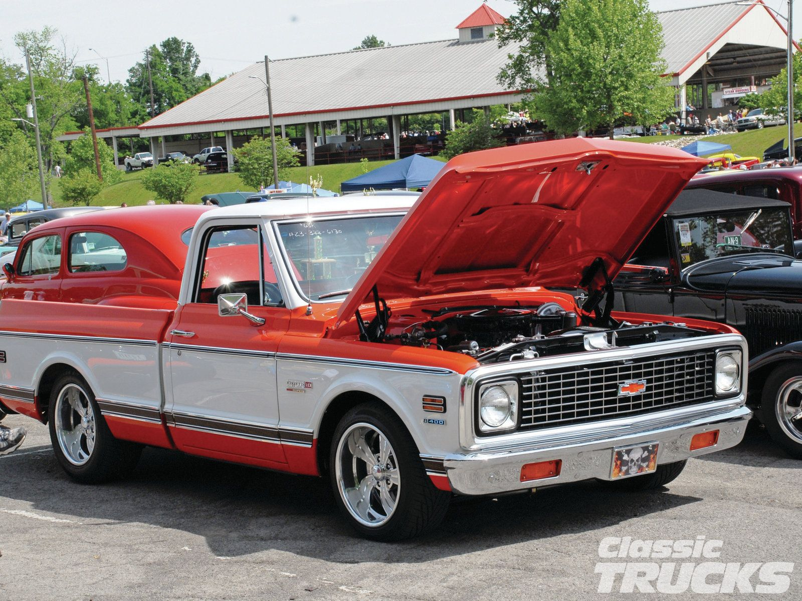 1971 chevy c10 in orange and white or it might be red and white
