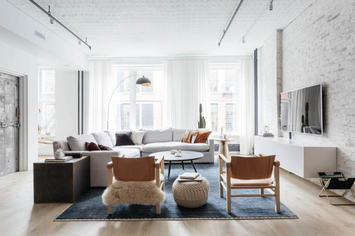 10 Tips For Embracing Scandinavian Design Without A Trip To Ikea Homepolish Living Room Scandinavian Living Room Furniture Sofas Trendy Living Rooms