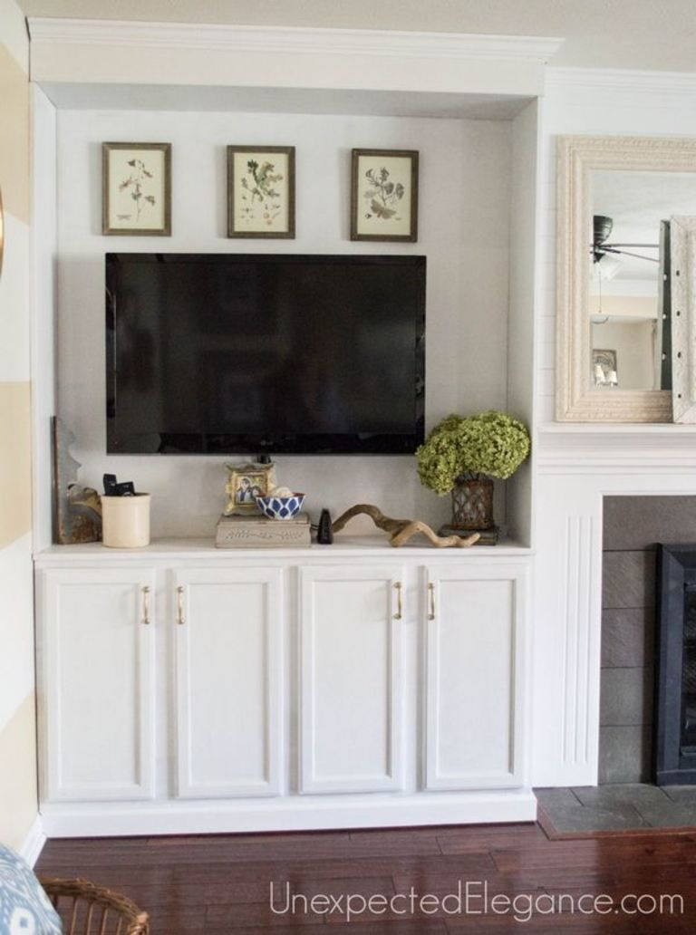 See how to transform you your living room with DIY fireplace built-ins! If completely changed the look of the space and made it feel bigger.