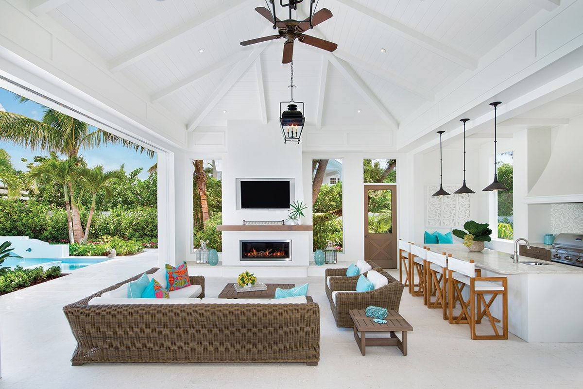 Styled With Comfortable Faux Wicker Furnishings Cushioned In Sunbrella S Performance Fabric And The Out Florida Interior Design Living Spaces Lanai Decorating