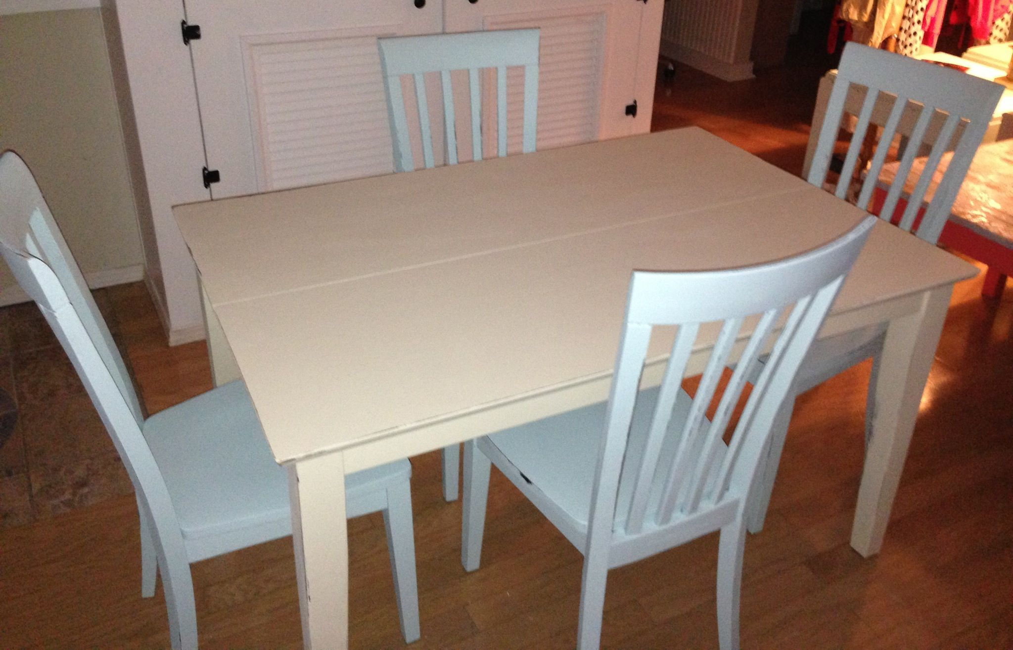 Bone white dining table with turquoise chairs. Looks cream in the photo, but it isn't.