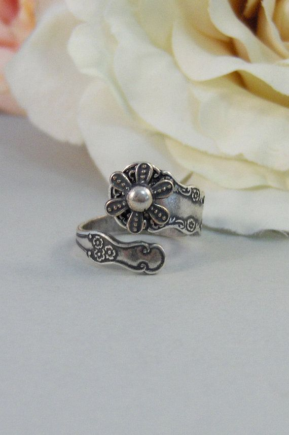 A little antiqued silver spoon ring,looks perfect on any finger. The spoon ring  wraps completely around your finger. Beautifully Elegant. The ring measures 3/4 an thick .  The ring band is self adjustable. This ring is made of antiqued silver plated over brass.  I have hand antiqued this ring to give it a lovely vintage feel. Measures a size 7 if you would like it to wrap around your finger, for larger sizes, it is self adjusable and will mold into a single band. Please click here for a Link back to my shop:  http://www.etsy.com/shop/valleygirldesigns?ref=si_shop Please click here for a link back to my other vintage rings: http://www.etsy.com/shop/ValleyGirlDesigns?section_id=11505742 All jewels are handmade and hand created by me in my home studio. Please know that you are purchasing a handcrafted item from Valleygirldesigns for you or for gift giving. Your jewels have never been worn and all items come from a smoke free home. Please allow 4-5 days for me to make your item and get it shipped out to you. All items come shipped in a speacial gift box perfect for gift giving.