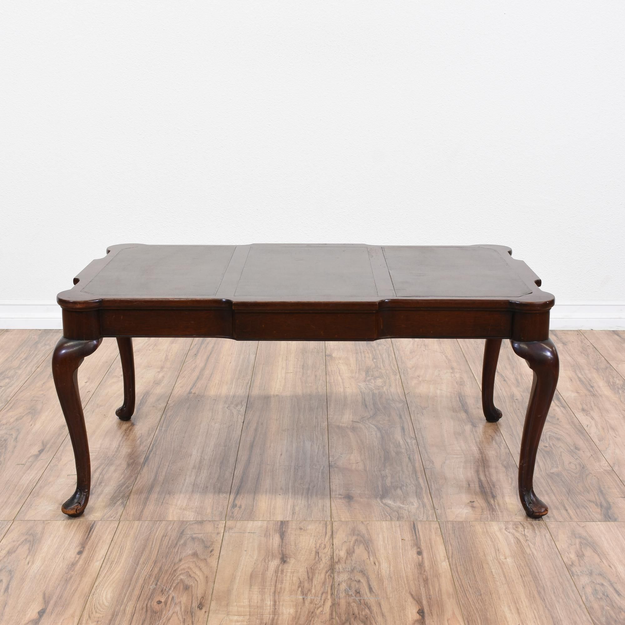 This Queen Anne style coffee table is featured in a solid wood