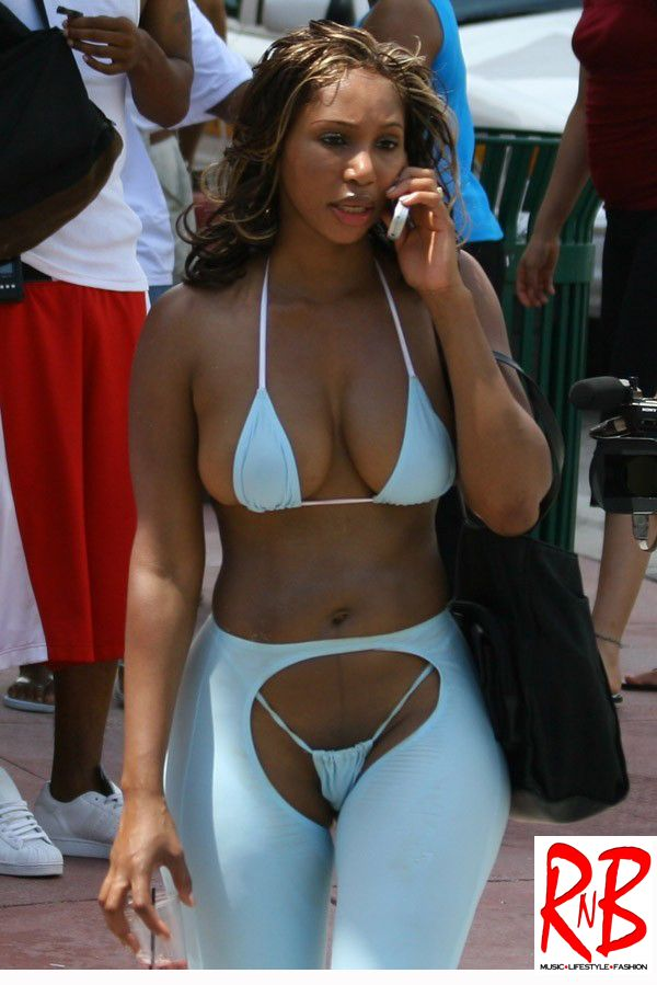 With her slim body and Dark blond hairtype without bra (cup size ) on the beach in bikini