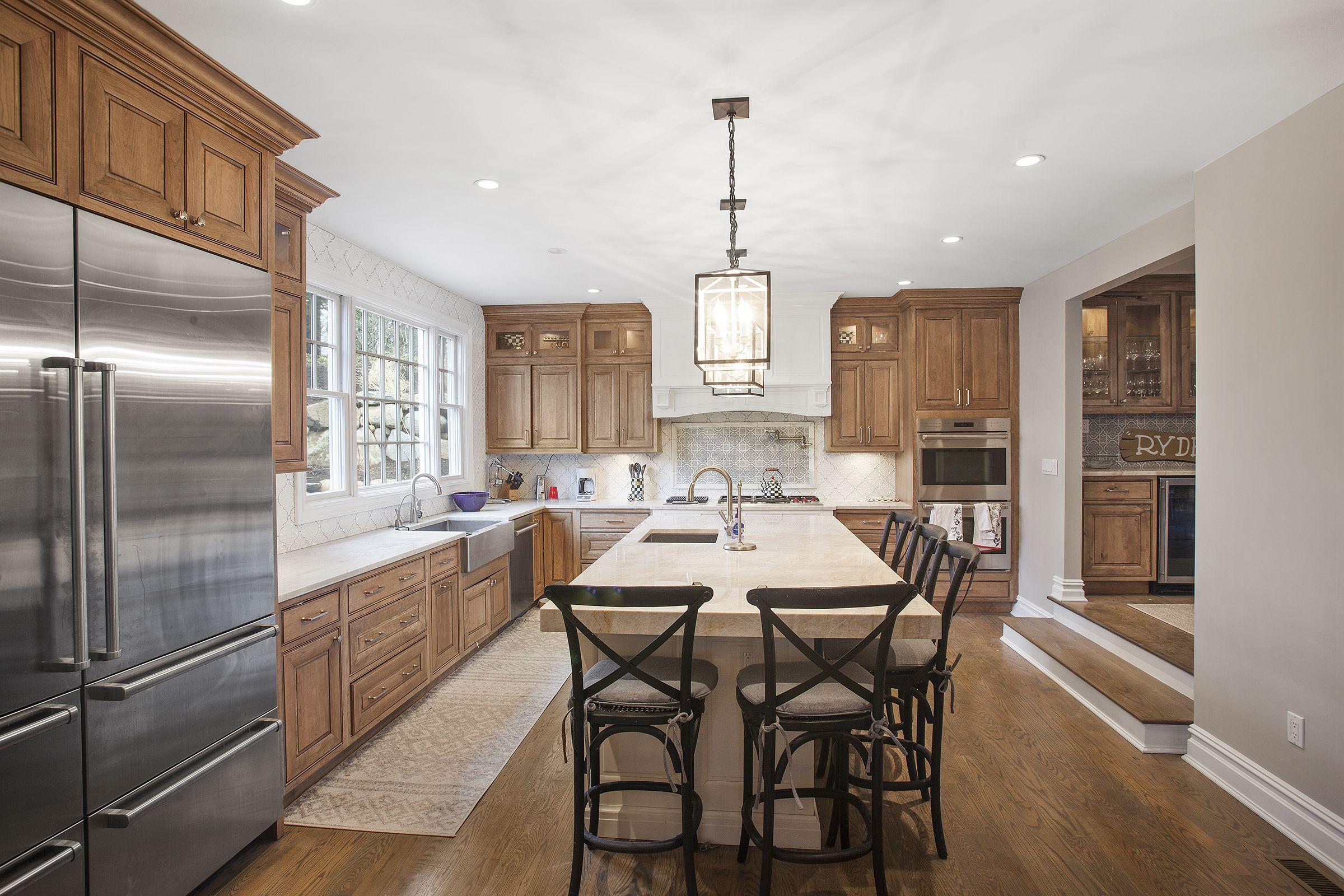 This Sunken Kitchen Boasts Stainless Steel Farm Sink Sink In Island Large Fridge And Freezer Wol Luxury Kitchen Design Kitchen Construction Kitchen Remodel