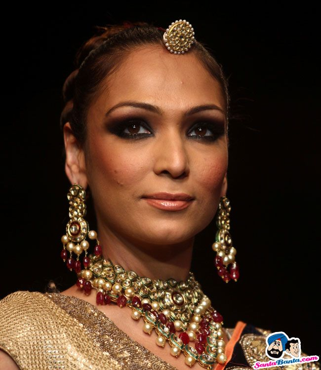 A model walks the ramp of the Indian International Jewellery Week ...