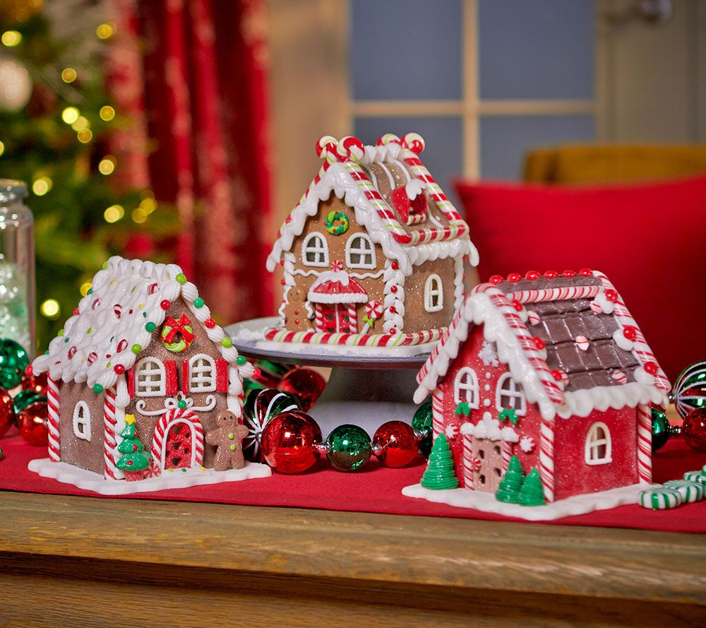 Makes a wonderful gift!  Illuminated mini gingerbread houses come with their own gift bag and tag!  H206047 http://qvc.co/-Shop-ValerieParrHill