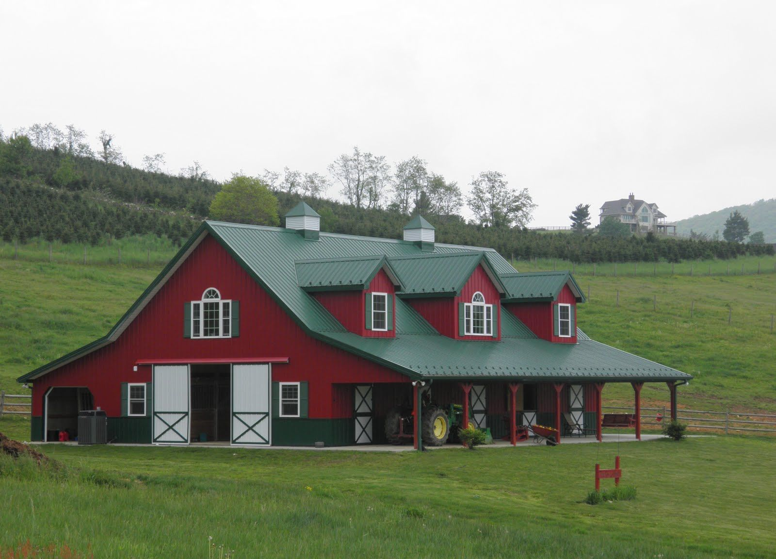 House that looks like red barn images at home in the for Metal pole barn homes plans