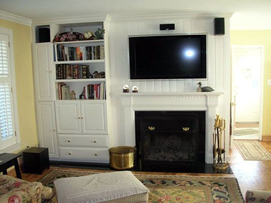 White Color Fireplace Mantel With Bookcase And Big Screen LED TV ...