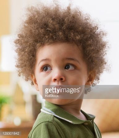 serious mixed race boy  natural hairstyles for kids boy