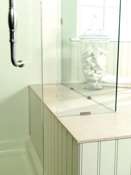 Shower walls, custom tub deck, wainscoting via Swanstone.com ...