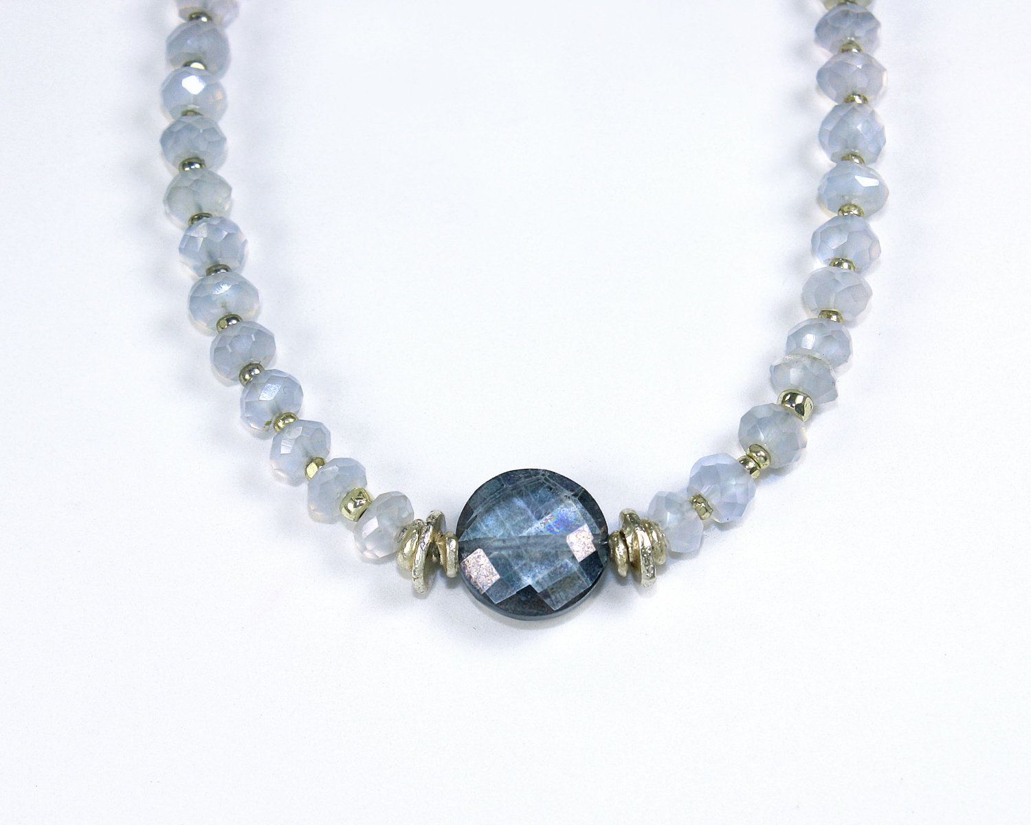 SALE Jubjub. Blue mystic topaz and chalcedony necklace with Sterling silver droplet beads and clasp. Silver blue and mauve. $38.99, via Etsy.