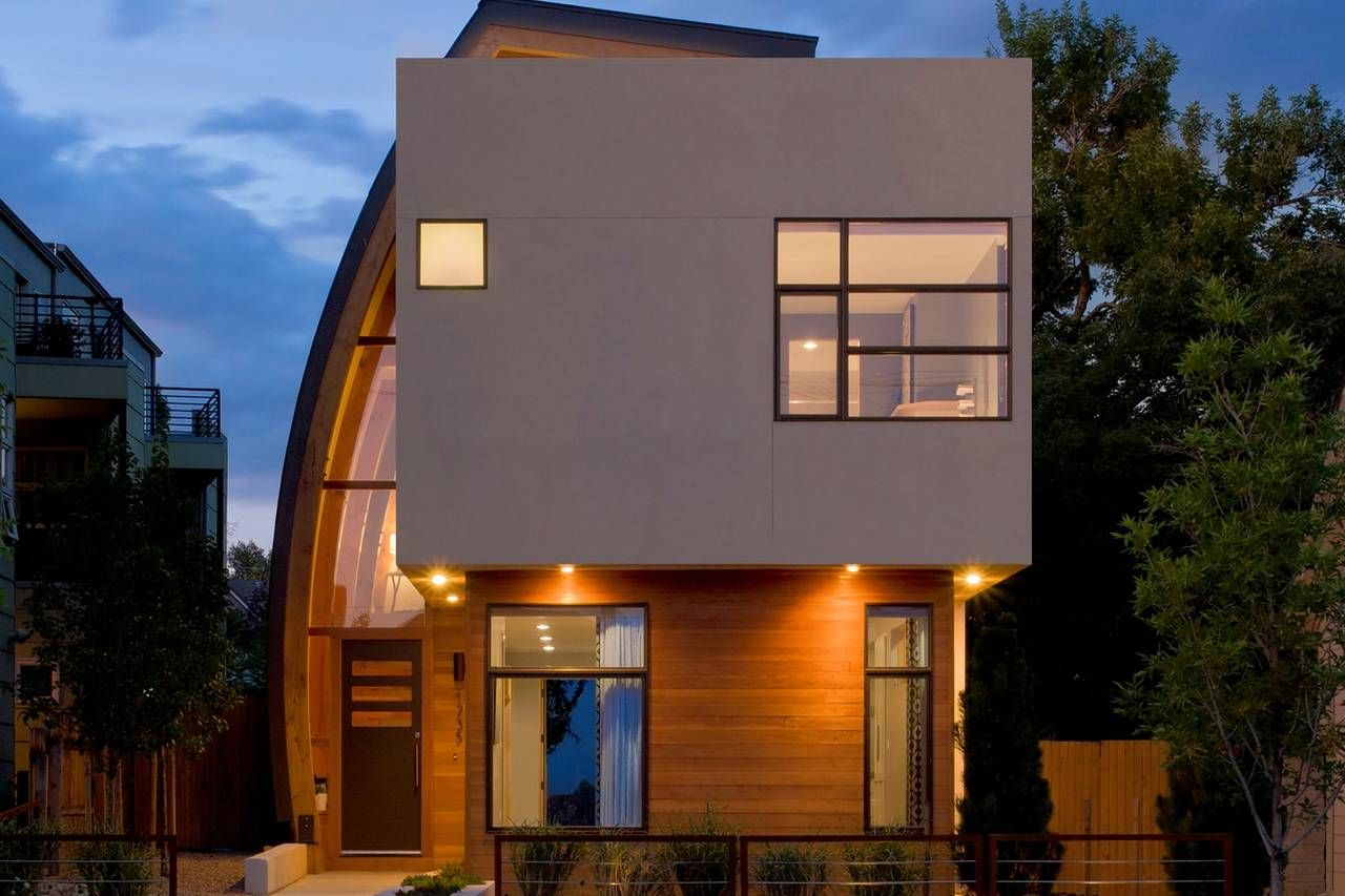 Nils ericksons home in denver has a large curved wall to shields the neighbors view