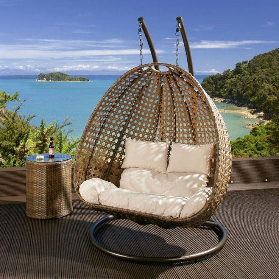 Genial Dark Brown Rattan Two Person Hanging Chair With Cream Cushion Covers.