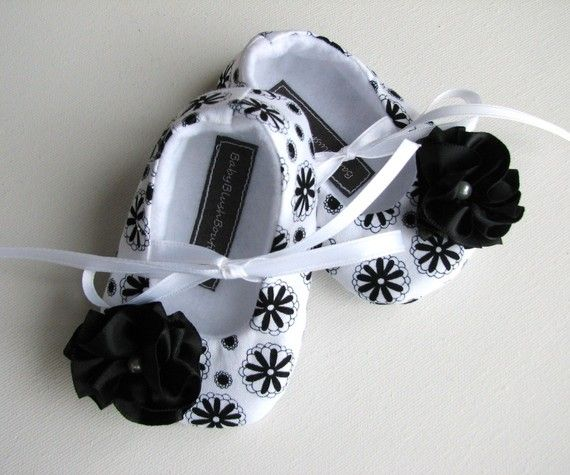 Black & White Floral Baby Soft Ballerina Slippers, made out of cotton fabric and felt. It has satin ribbon flower embellishment with a pearl bead to make it more attractive. This shoes are soft for those delicate baby or infant feet.It comes with a ribbon tie strap. #timelesstreasure