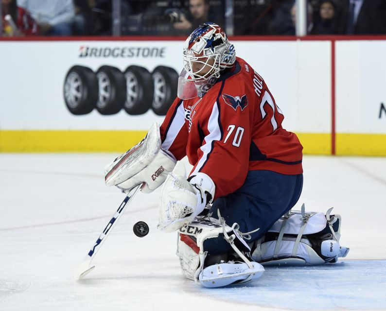 Washington Capitals goalie Braden Holtby (70) makes a save against the Toronto Maple Leafs during the first period in Game 1 of an NHL hockey Stanley Cup first-round playoff series in Washington, Thursday, April 13, 2017.