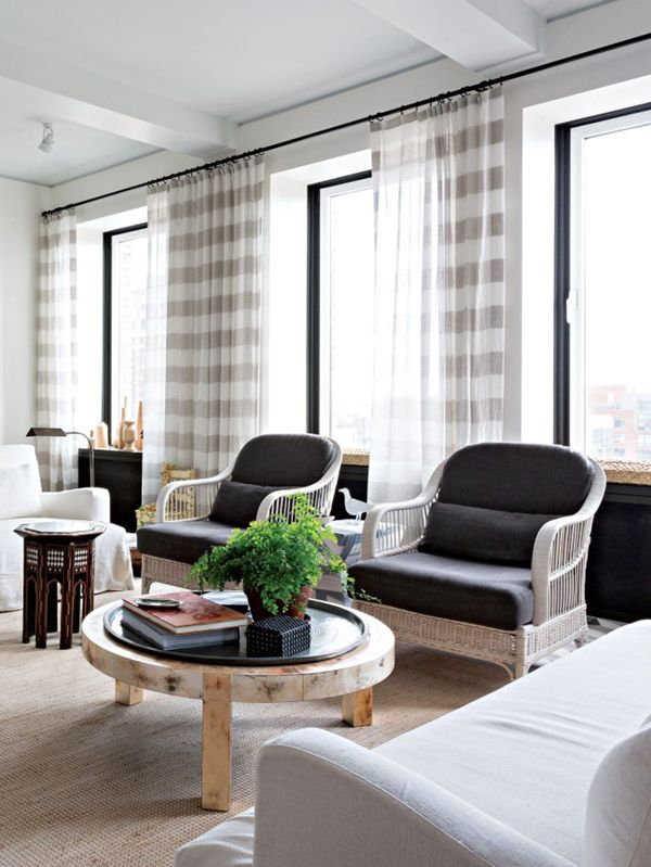 tiled living room with neutral textures and striped curtains via ...