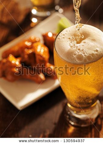 Pouring Beer With Chicken Wings In Background Cerveza Todo Lo