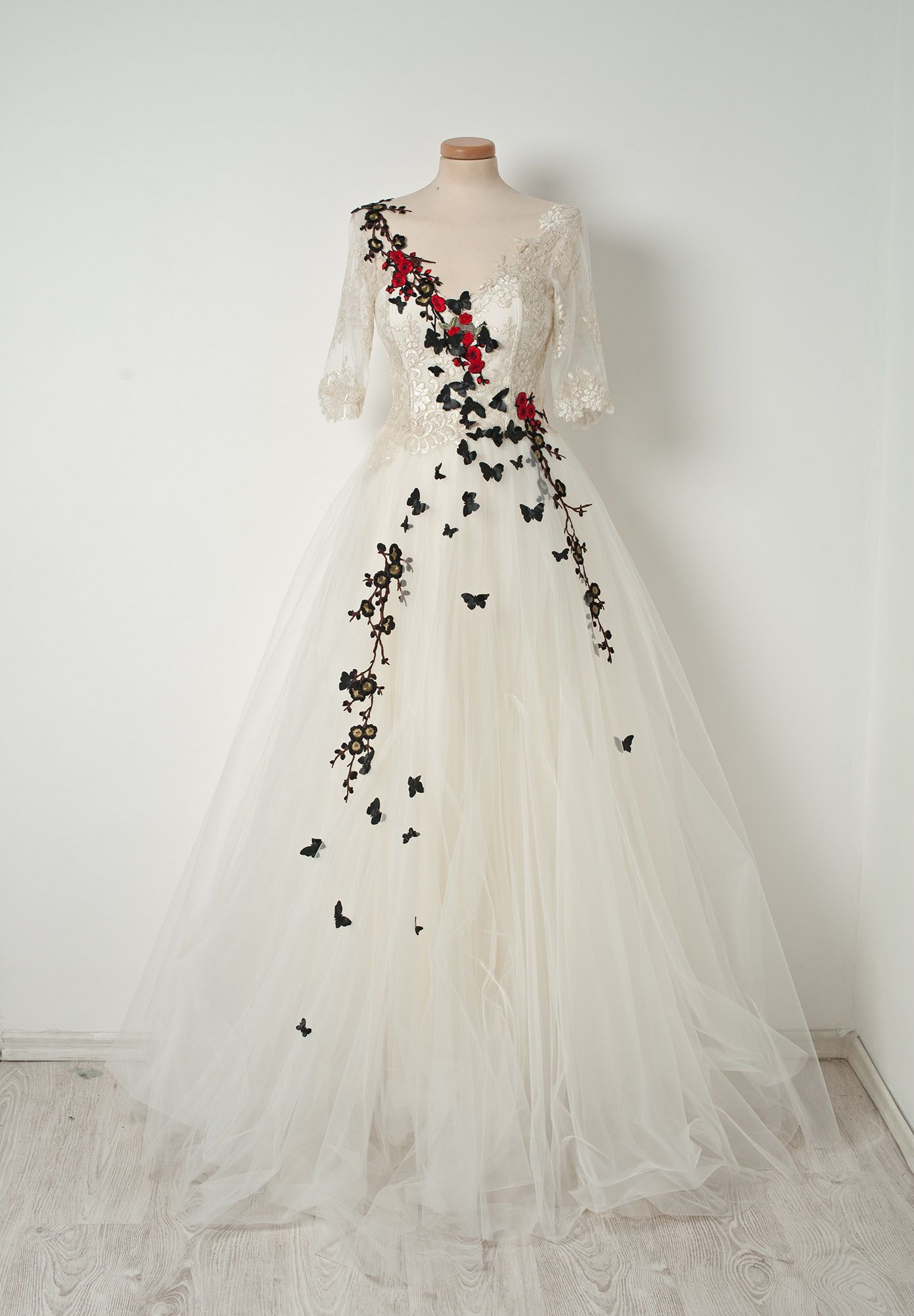 Wedding gown with red accents  Take a creamy tulle mousse and mix it with delicious ivory lace