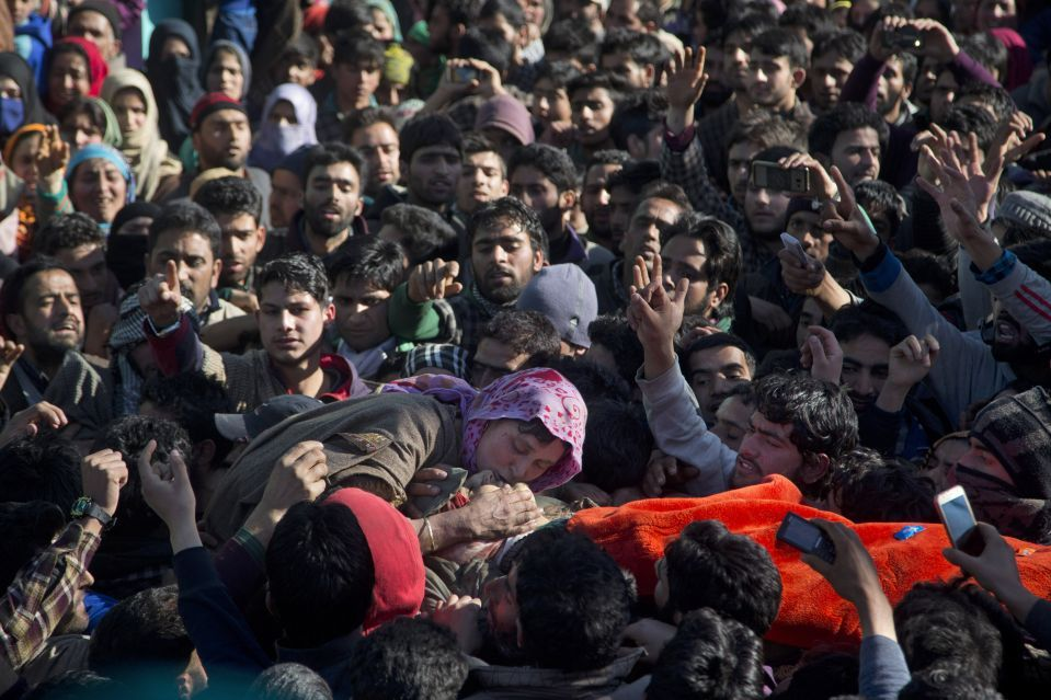 The mother of a suspected rebel killed in a gunbattle with government forces grieves during his funeral procession in Bandnu village, some 33 miles south of Srinagar, in India-controlled Kashmir.  DAR YASIN/ASSOCIATED PRESS