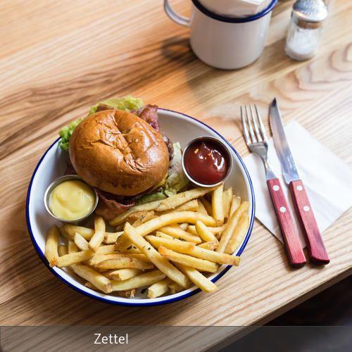 **In entspannter Atmosphäre hervorragende Burger genießen – geht bei Otto's Burger im Hamburger Schanzenviertel ganz hervorragend. Ein paar Möbel im…