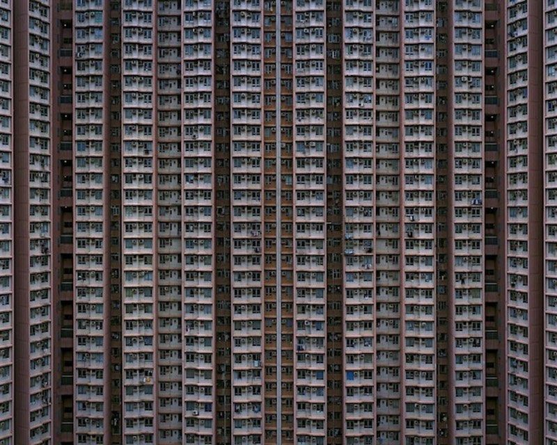 """The photographer Michael Wolf's study of Hong Kong, """"The Architecture of Density,"""" began with the SARS outbreak in 2002. As many people became sick and others left the city, it dawned on Wolf that, despite eight years in the city as a photojournalist for the German magazine Stern, he had never completed a personal project. """"I bundled up wife and son and sent them back to Germany and I stayed in Ho..."""