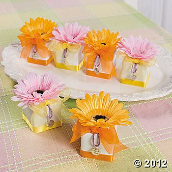 """An old proverb says """"Spring has come when you can put your foot on three daisies."""" Not only can daisies let us know when spring is here, the daisies on our gorgeous gerbera daisy favor boxes herald a wonderful event--perhaps a wedding or a baby on the way. These beauties from Mother Nature's bouquet create a garden of gladness wherever they go!  #timelesstreasure"""