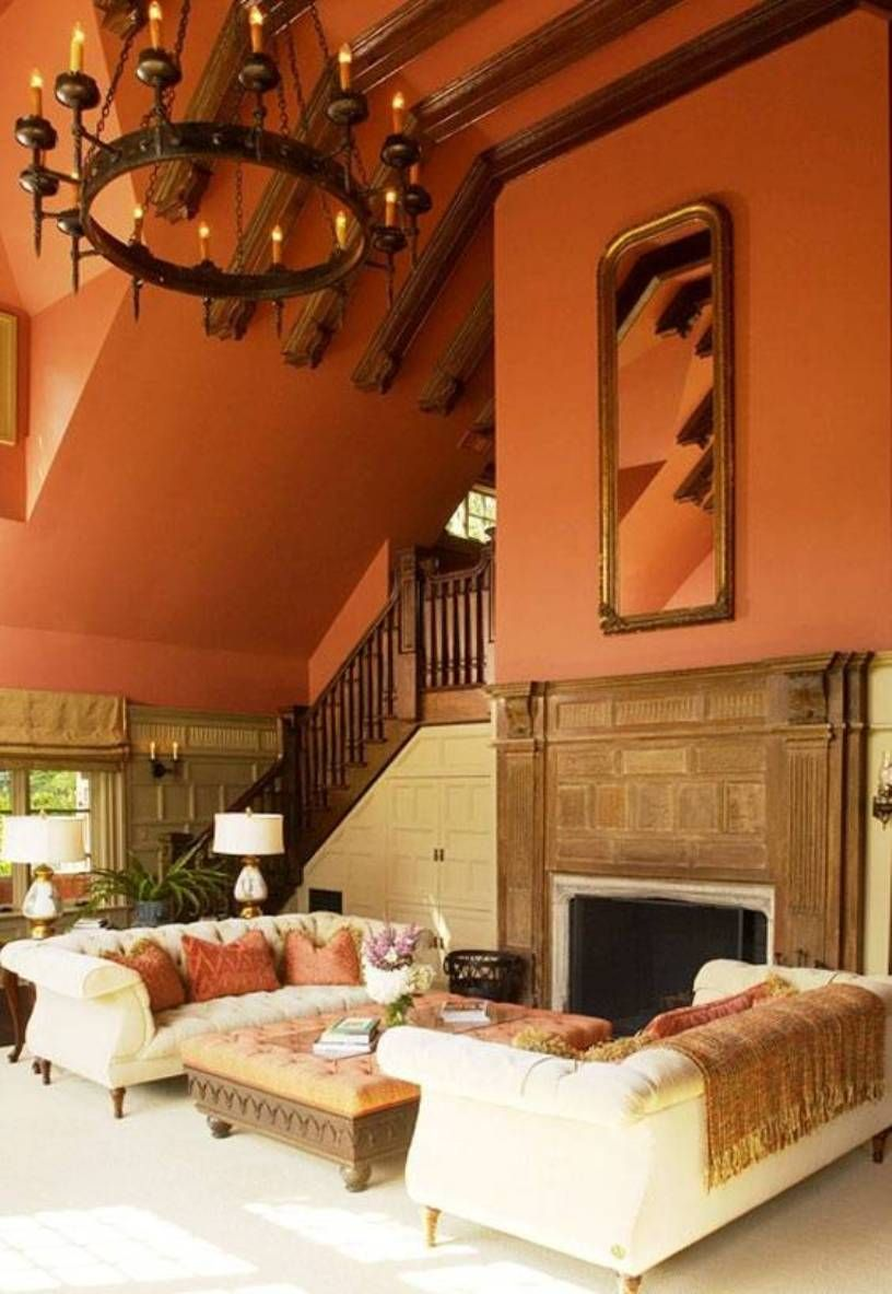 Mexican Style Living Room With High Ceiling And White Couches And Vertical Mirror Over Fireplace And Living Room Orange Orange Rooms Living Room Color Schemes #paint #ideas #for #living #room #with #high #ceilings