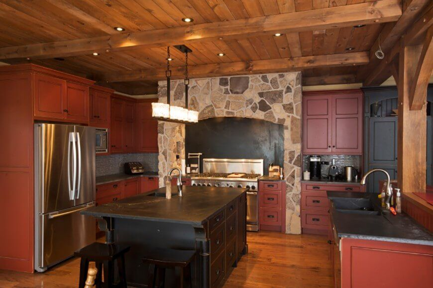 A Rustic Kitchen With Wooden Beams Ceiling And Floor Stone Enclosure For The Stove Distressed Cabinetry Island This Is Chiefly