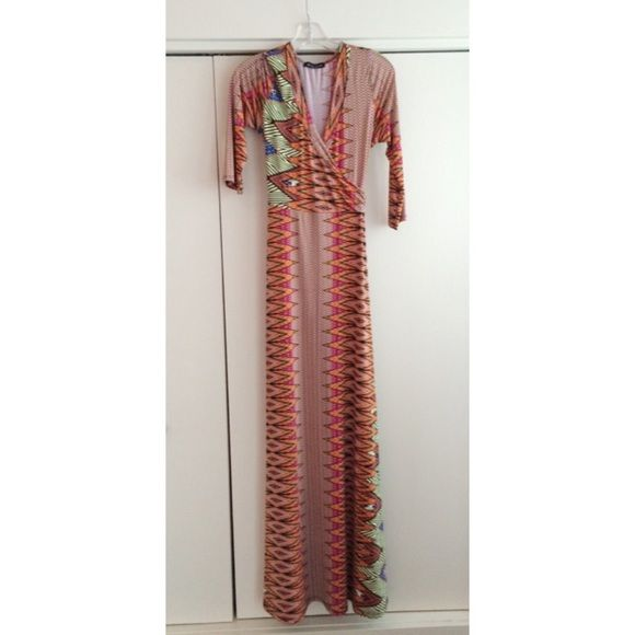 Tribal Wrap Dress Maxi Jeanette Fashion Tribal Wrap Dress Maxi in Orange and Pink. Only worn once⚡️FLASH SALE ENDS AT 11:59 PM  PST FRIDAY NIGHT ⚡️ Jeanette Fashion Dresses Maxi