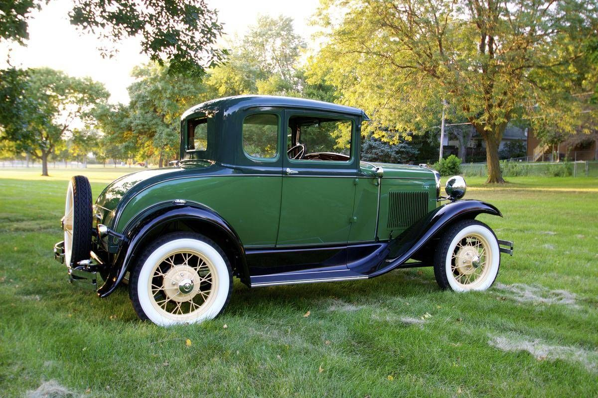 1930 Ford Model A Coupe. Black over Green with Whitewall