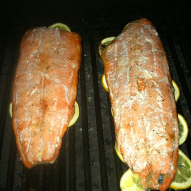 Salmon on the grill. I use sliced lemons underneath the salmon to prevent sticking and for an easy cleanup